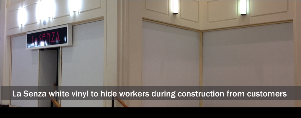Slide 6 La Senza white vinyl to hide workers during construction from customers